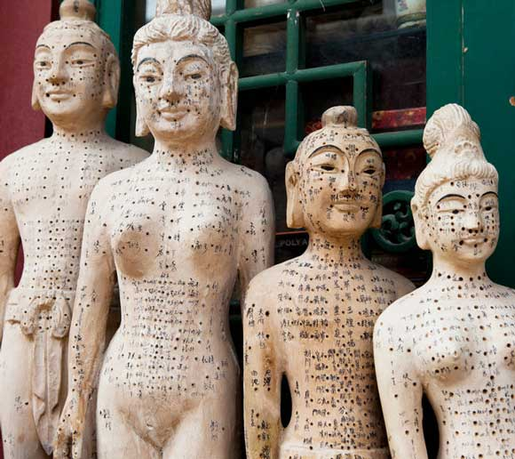 Old wooden acupuncture dolls